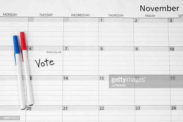 election day calendar reminder: vote - election day stock photos and pictures