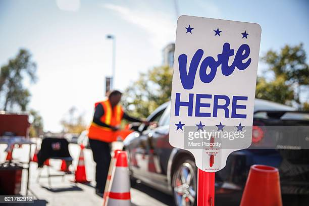 Election judge Ed Wingfield of Denver Colorado accepts ballots outside the Denver Elections Division offices on November 8 2016 in Denver Colorado...