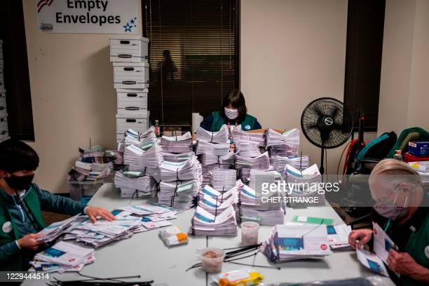 Election judges verify and count ballots at the Denver Elections Division building on November 3, 2020 in Denver, Colorado. - The United States...