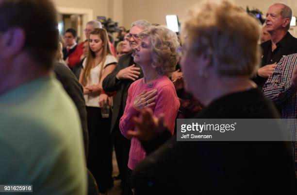 Election night supporters sing the National Anthem at an event for GOP PA Congressional Candidate Rick Saccone as the polls close on March 13 2018 at...
