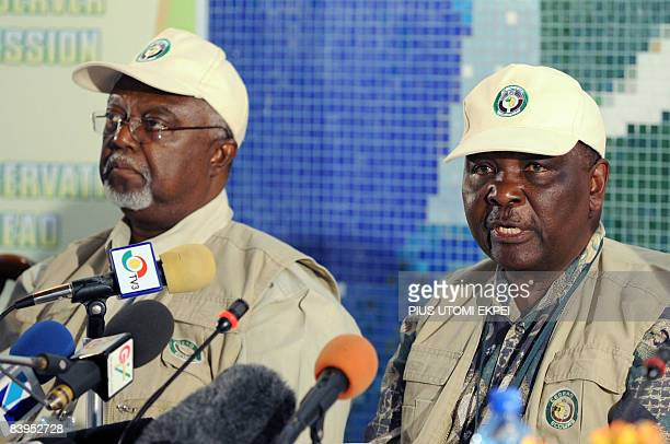 Election observer and former Liberian President Amos Sawyer listens as leader of Economic Community of West African States observation team led by...