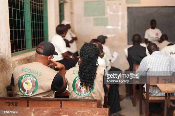 Election observers of Economic Community of West African States watch the vote counting process after the parliamentary elections in Bakau Gambia on...