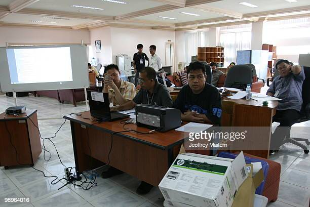 Election officers are seen at the old provincial capitol of Maguindanao as vote counting continues to try to determine the next President of the...