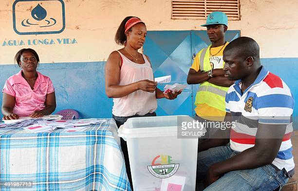 Election officers count ballots before the start of vote counting during the general elections in Bissau GuineaBissau on May 18 2014 GuineaBissau...