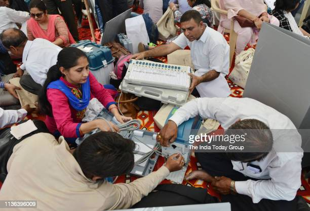 Election official clicked while checking Electronic Voting Machine and other election related material at a distribution centre a day before the...
