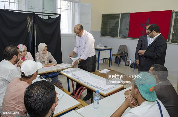 Election official start to count ballots at a polling station as the municipal elections ballot casting period ends in Rabat Morocco on September 4...