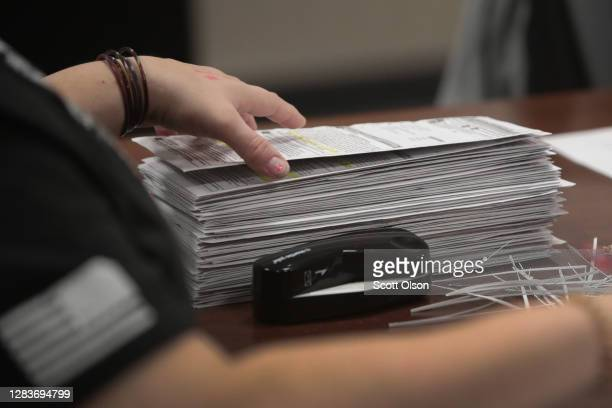 Election officials begin counting absentee ballots at City Hall on November 03, 2020 in Beloit, Wisconsin. Wisconsin requires election officials to...