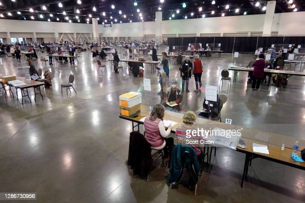 Election officials begin the recount process of ballots from the November 3 election at the Wisconsin Center on November 20, 2020 in Milwaukee,...