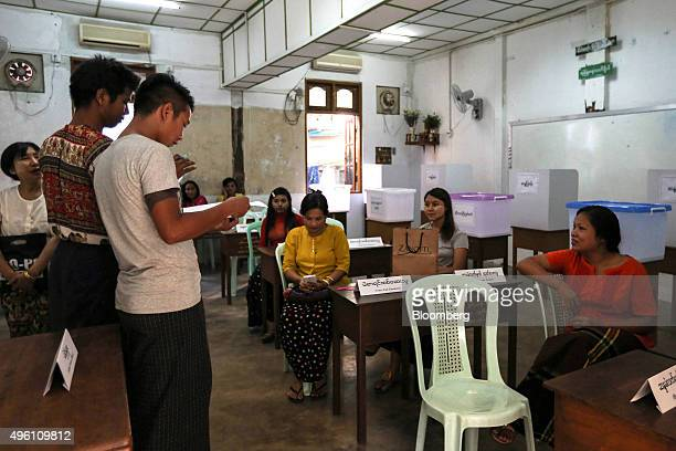 Election officials carry out a briefing inside a polling station in Yangon Myanmar on Saturday Nov 7 2015 Myanmar's campaign has ended and voters...