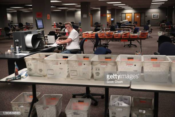 Election officials count absentee ballots on November 04, 2020 in Milwaukee, Wisconsin. Wisconsin requires election officials to wait to begin...