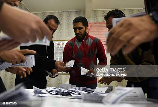 Election officials count ballots at the end of the second round of voting for Egypt's parliamentary election in the Egyptian capital Cairo on...