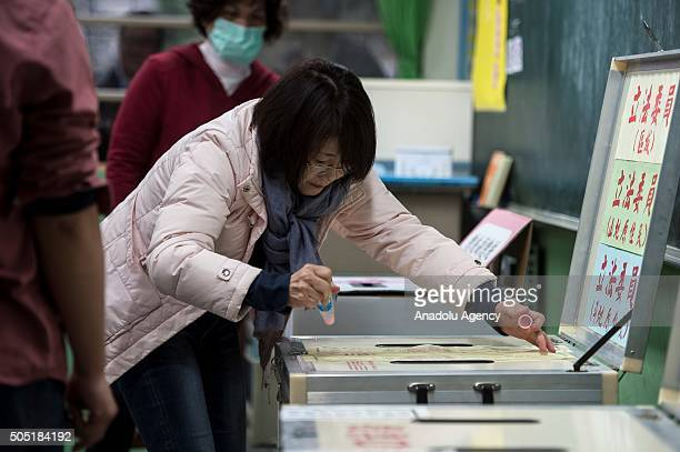 Election officials prepare a ballot box prior to the start of presidential elections in New Taipei City, Taiwan on January 16, 2016.