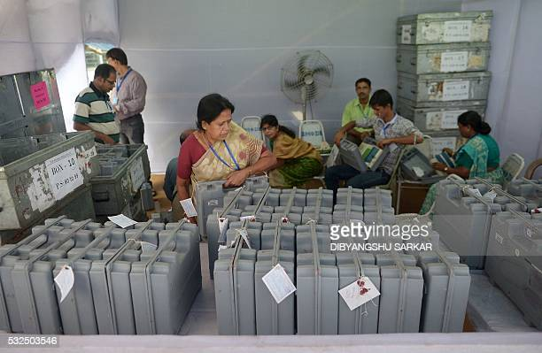 Election officials seal the Electronic Voting Machines at close of counting for the West Bengal state assembly elections in Kolkata on May 19 2016...