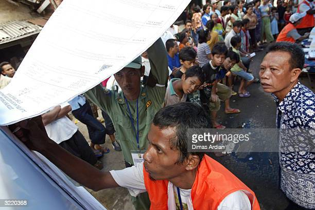 Election officials tally poll results April 5 2004 in Jakarta Indonesia Around 147 million eligible voters in the world's most populous Muslim nation...