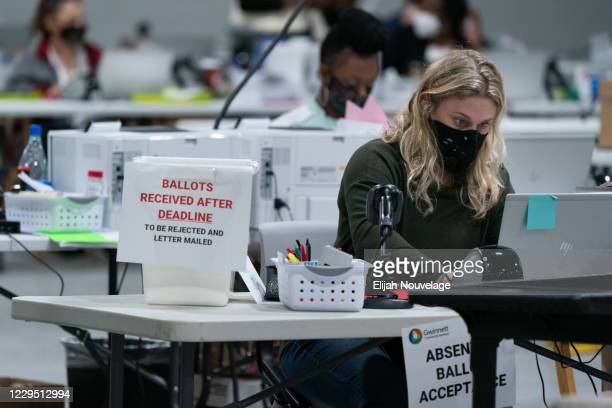Election personnel check in provisional ballots at the Gwinnett County Board of Voter Registrations and Elections offices on November 7, 2020 in...