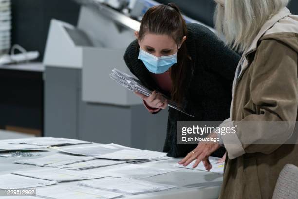 Election personnel sort absentee ballot applications for storage at the Gwinnett County Board of Voter Registrations and Elections offices on...