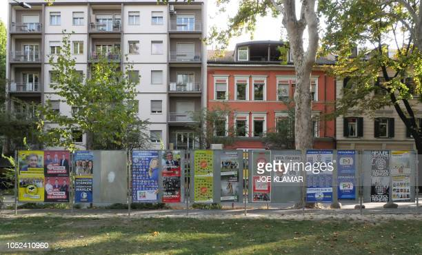 Election posters are pictured in Bolzano Italy on October 15 2018 The Austrian government has raised hackles in Italy by suggesting it could offer...