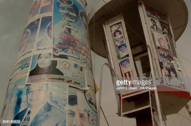 Election posters cover lampposts and other available space outside the Blue Mosque in MazareSharif in northern Afghanistan The votes are still being...
