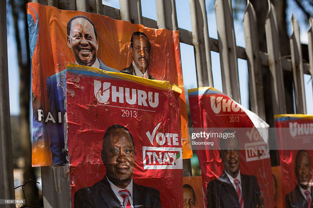 Election posters for presidential candidates Uhuru Kenyatta, Kenya's deputy premier, and Raila Odinga, Kenya's prime minister, hang from street railings ahead of the election in Nairobi, Kenya, on Friday, March 1, 2013. Next week's presidential vote will be the first since disputed elections in 2007 triggered ethnic fighting in which more than 1,100 people died and another 350,000 fled their homes. Photographer: Trevor Snapp/Bloomberg via Getty Images