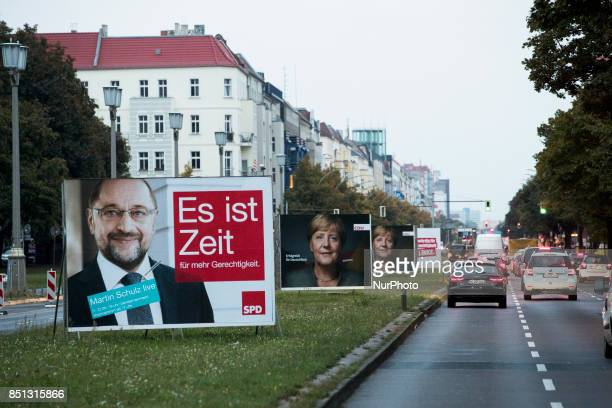 Election posters of chancellor candidate of the Social Democratic Party Martin Schulz and of German Chancellor Angela Merkel are pictured in the...