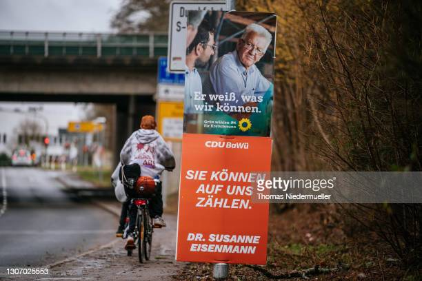 Election posters of Winfried Kretschmann, premier of Baden-Wuerttemberg and member of the German Greens Party and Susanne Eisenmann, lead candidate...