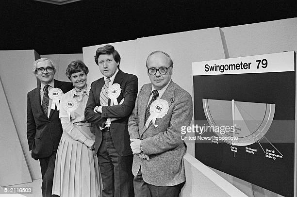 BBC Election presentation team posed beside the swingometer in a BBC television studio set in preparation for an upcoming election coverage programme...