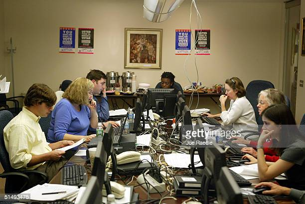 Election Protection legal volunteers work the phones as they speak to early voters who call in with complaints about the voting procedures in their...