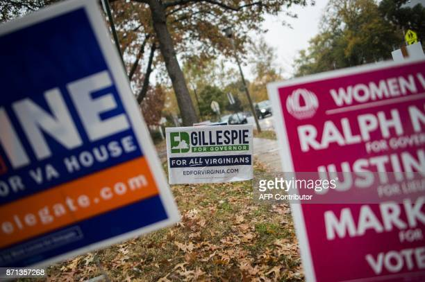 Election signs are seen outside a polling station in Arlington Virginia on November 7 2017 In New Jersey and Virginia voters will elect a new...