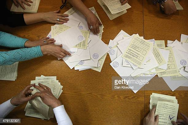 Election staff begin the count at a polling station after a day of voting on March 16 2014 in Bachchisaray Ukraine Crimeans go to the polls today in...