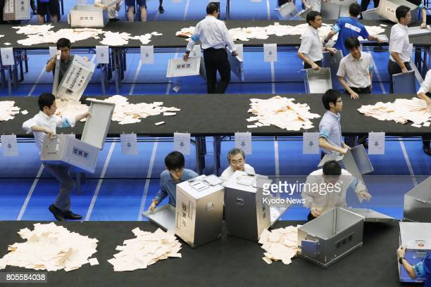 Election staff count votes cast in the Tokyo metropolitan assembly election on July 2 2017 Tokyo Gov Yuriko Koike's Tomin First no Kai and forces...
