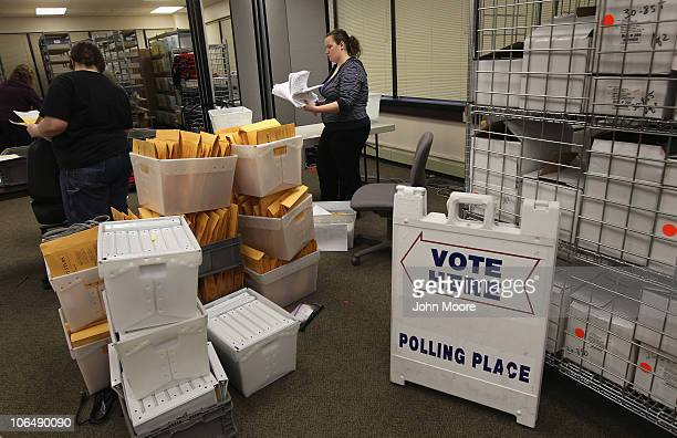 Election worker Dallas Reynolds sorts election material received from polling places at the Alaska state elections office on November 3 2010 in...