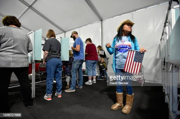 Election worker Leah Barney watches over voters as they cast their ballots on November 6, 2018 in Las Vegas, Nevada. Turnout is expected to be high...