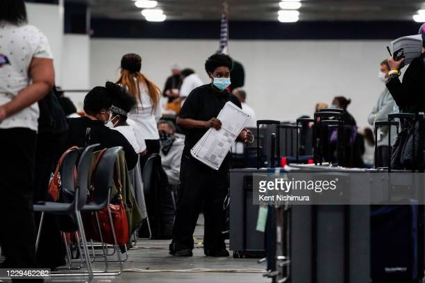 Election workers and Election observers and challengers at the Detroit Department of Elections Central Counting Board Voting at TCF Center,...