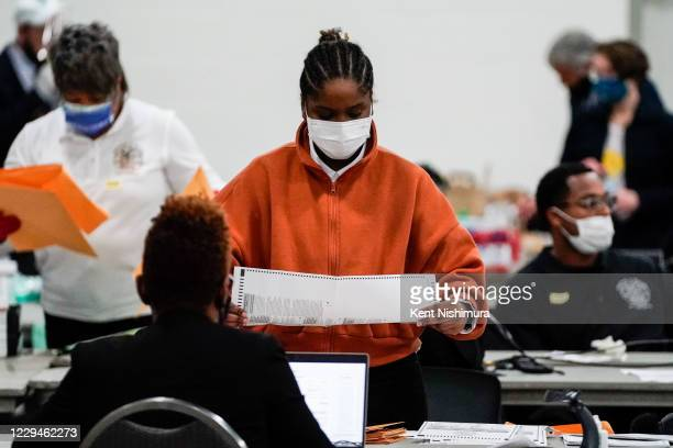 Election workers check ballots at the Detroit Department of Elections Central Counting Board Voting at TCF Center, Wednesday, Nov. 4, 2020 in...