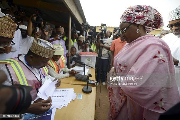 Election workers check documents of the wife of main opposition All Progressives Congress presidential candidate Mohammadu Buhari Aisha on March 28...