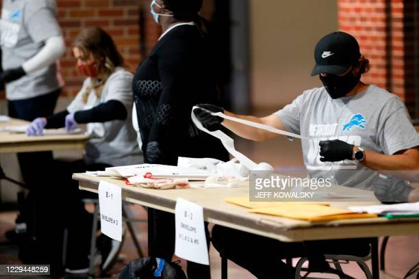 Election workers check the tapes from the voting machines to verify they contain the correct signatures from polling stations after polls closed in...