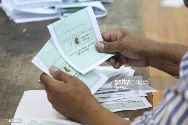 Election workers count ballots at the end of second-day vote of the upper house election for the newly created Senate on August 12, 2020 in Zamalek,...