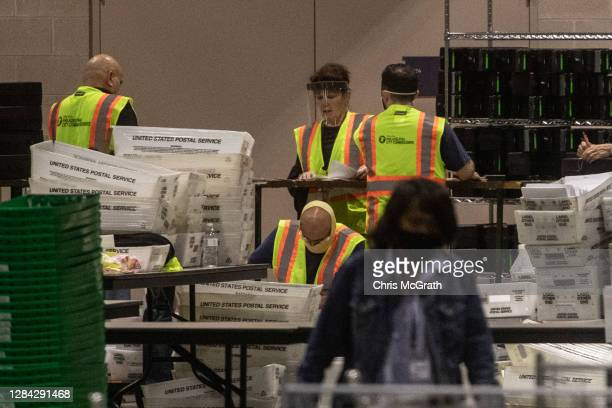 Election workers count ballots at the Philadelphia Convention Center on November 06 2020 in Philadelphia Pennsylvania Joe Biden took the lead in the...