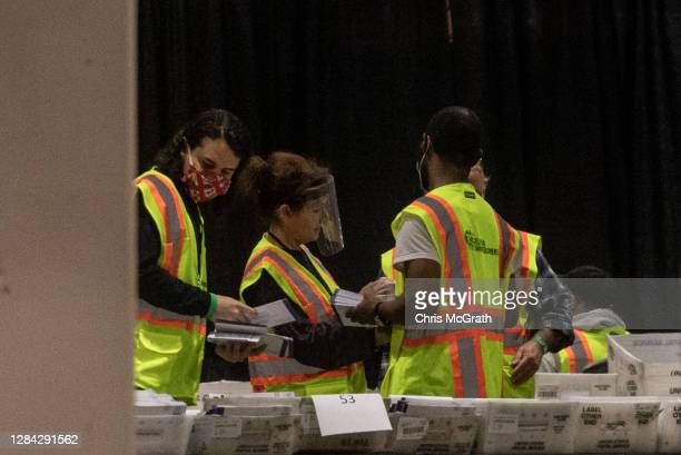 Election workers count ballots at the Philadelphia Convention Center on November 06, 2020 in Philadelphia, Pennsylvania. Joe Biden took the lead in...