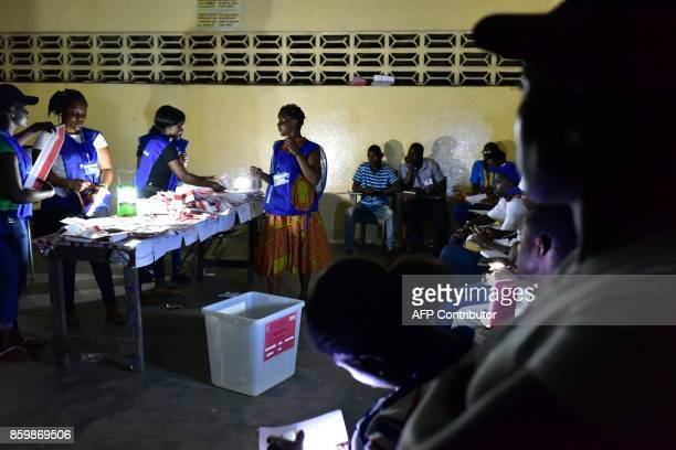 TOPSHOT Election workers count ballots of Liberian presidential and legislatives elections on October 10 2017 Liberians turned out in force on...