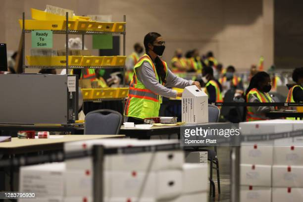 Election workers count ballots on November 03, 2020 in Philadelphia, Pennsylvania. After a record-breaking early voting turnout, Americans headed to...