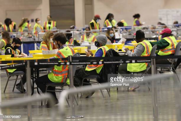 Election workers count ballots on November 03 2020 in Philadelphia Pennsylvania After a recordbreaking early voting turnout Americans headed to the...