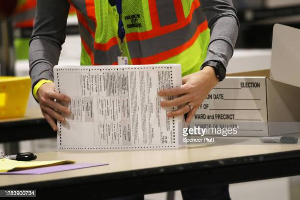 Election workers count ballots on November 04 2020 in Philadelphia Pennsylvania With no winner declared in the presidential election last night all...