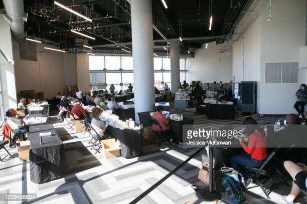 Election workers count Fulton County ballots at State Farm Arena on November 4, 2020 in Atlanta, Georgia. The 2020 presidential race between...