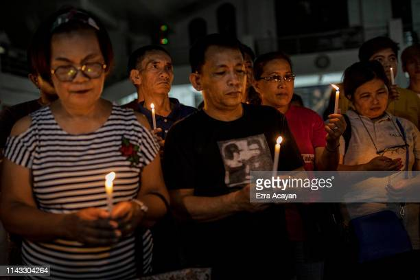 Election workers light candles as they take part in a prayer vigil calling for clean and honest elections on May 12 2019 in Quezon city Metro Manila...