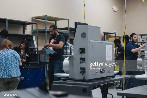 Election workers prepare to scan ballots in an electronic counting machine during a recount at the Broward County Supervisor of Elections office in...