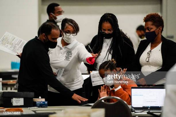 Election workers process a ballot final stretch of absentee ballot counting at the Detroit Department of Elections Central Counting Board of Voting...