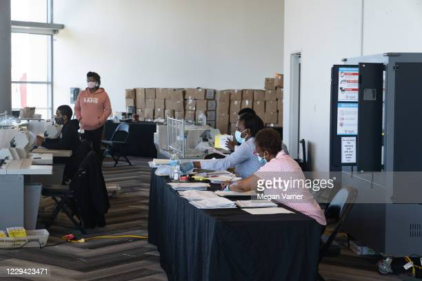 Election workers process absentee ballots at State Farm Arena on November 2, 2020 in Atlanta, Georgia. With record-breaking early voting turnout,...