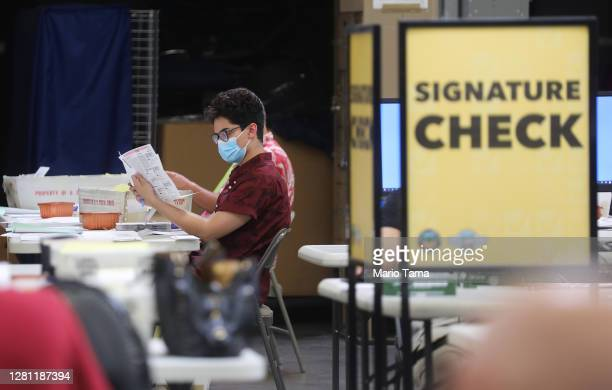 Election workers process mail-in ballots at the Orange County Registrar of Voters on October 19, 2020 in Santa Ana, California. California Secretary...