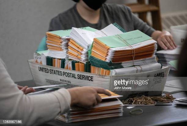 Election workers sort absentee ballot envelopes at the Lansing City Clerk's office on November 02, 2020 in Lansing, Michigan. For the first time,...